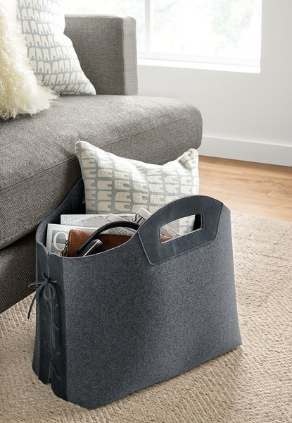 Store magazines and more in this sturdy felt tote. Leather laces and handles create a sophisticated mix of materials. The tote stands upright so you can easily place it next to your sofa or under your desk.  Photo 2 of 9 in How to Use Modern Home Decor in Unexpected Ways