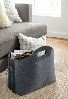 Use an unusual basket or tote as both an organizational tool and statement piece. The tote stands upright so you can easily place it next to your sofa or under your desk.