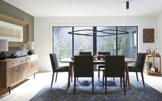 Ventura dining table, Ava chairs, Grove cabinet, Simone lamp, Heriz rug