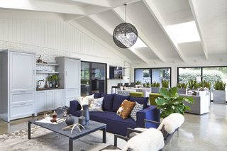 Oasis sofa, Rand cocktail table, Filigri rug, Lira chairs, Sheepskin rugs