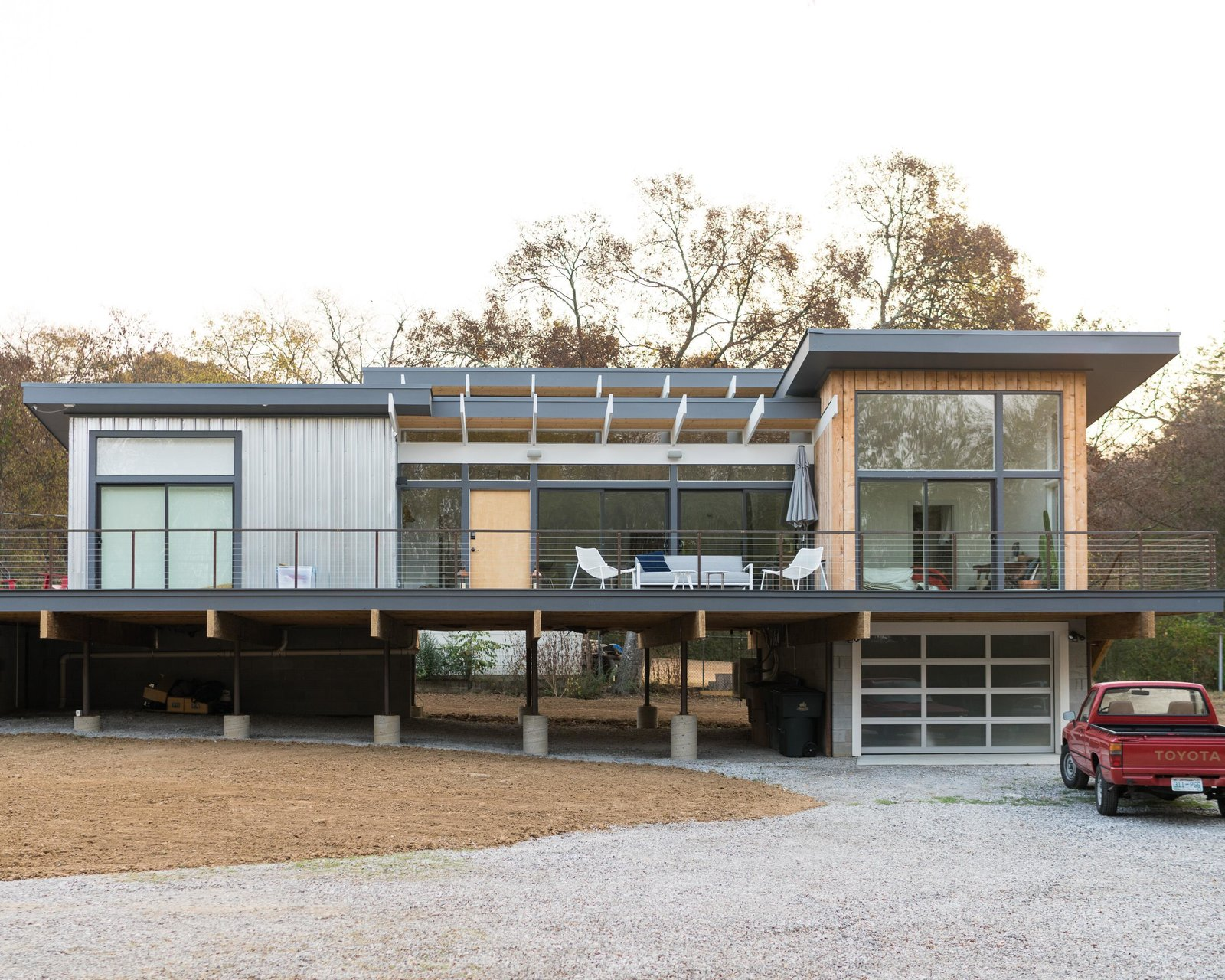 Exterior, Flat RoofLine, House Building Type, Wood Siding Material, and Metal Siding Material Theron Humphrey's new home in Nashville, Tenn.  Photo 1 of 11 in Home Tour: Theron Humphrey of This Wild Idea