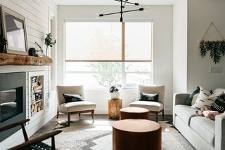 Edwin chairs, leather round Aero ottomans, Ian sofa