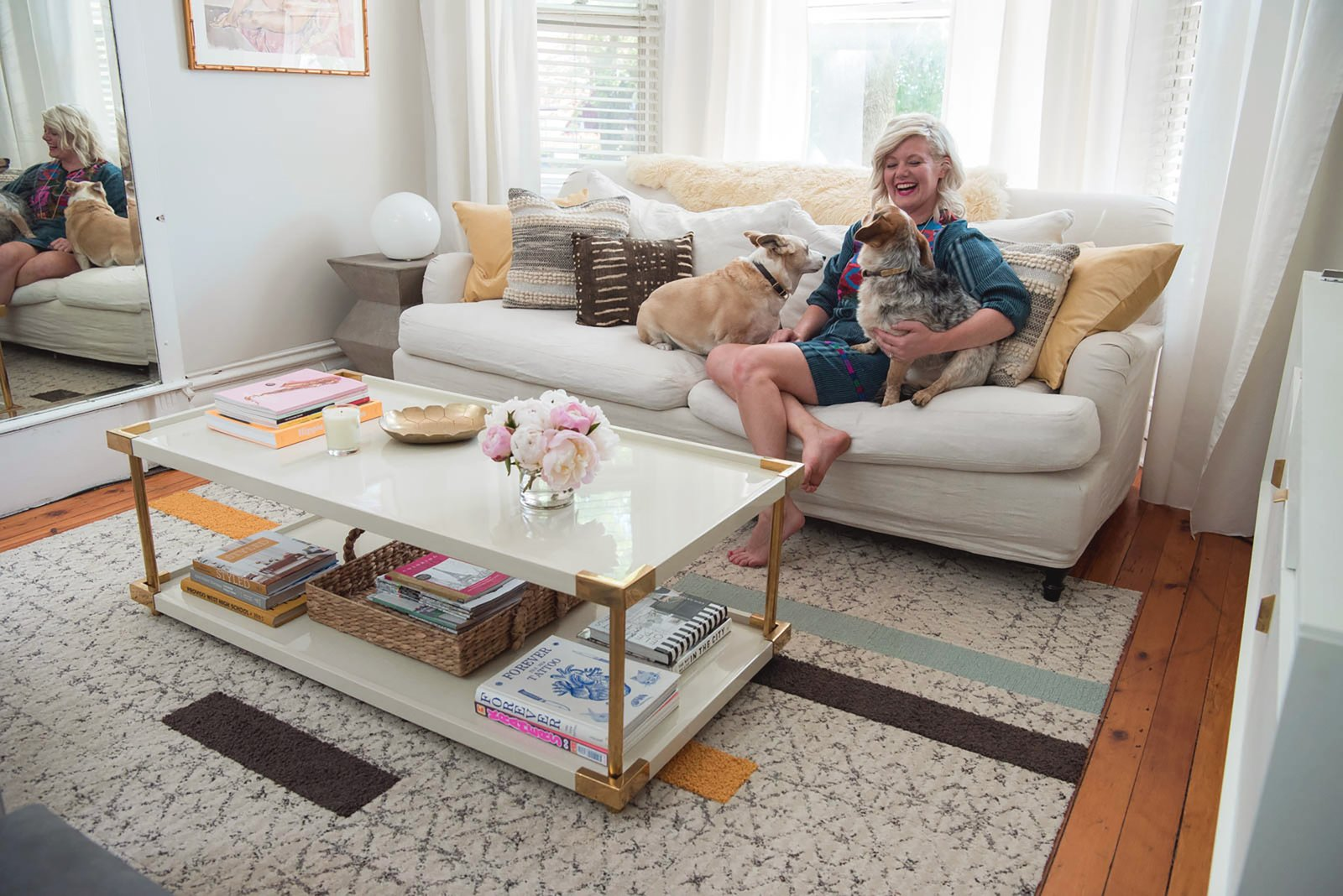Living Room, Sofa, Rug Floor, Table Lighting, End Tables, Medium Hardwood Floor, and Coffee Tables  Photo 1 of 7 in 6 Popular Houseplants to Avoid When You Live With Pets from By Design Q&A: Dean Renaud