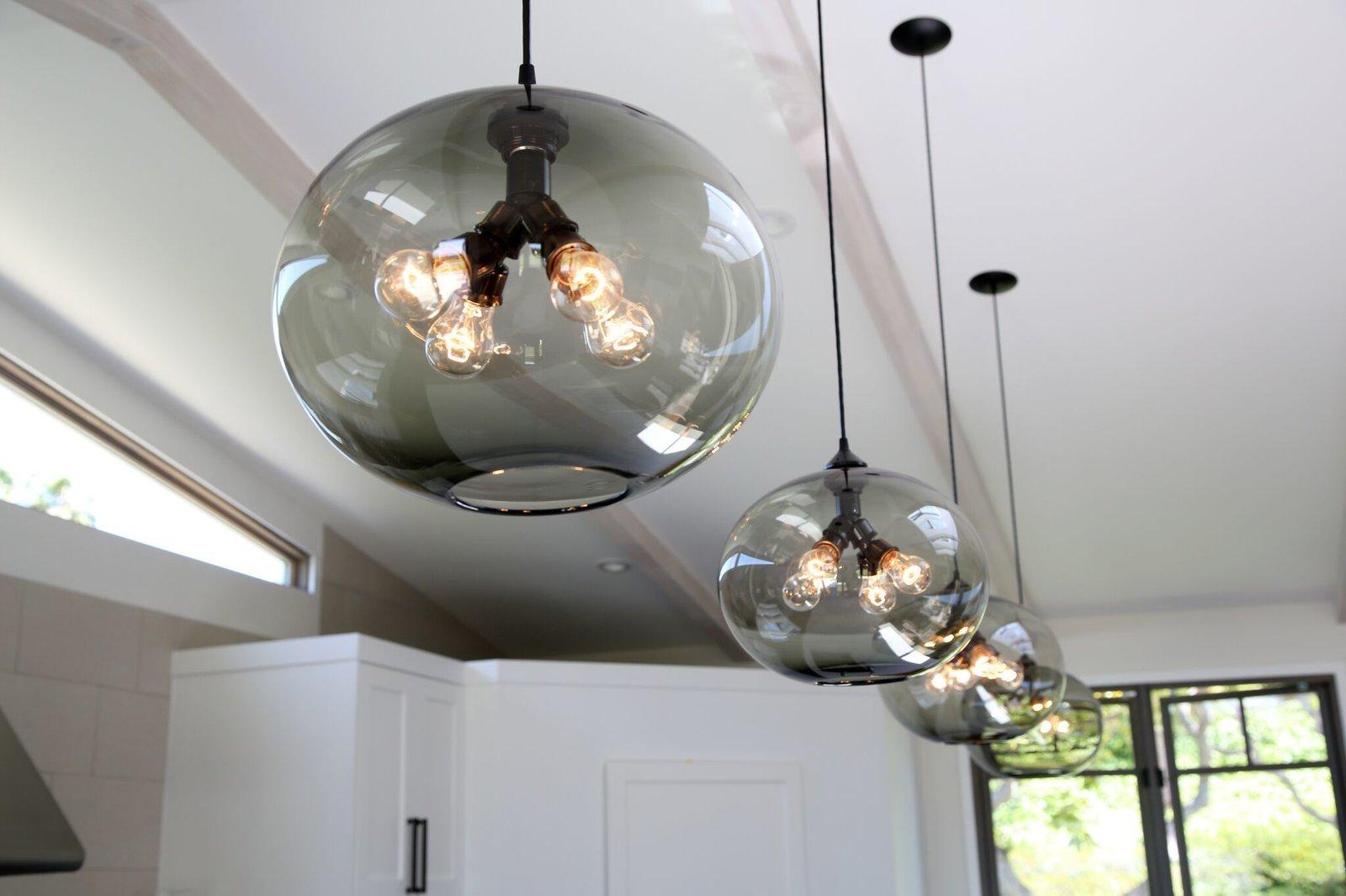 Photo 3 of 5 in Kitchen Island Modern Lighting Adds Minimalist Feel to California Home