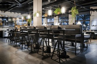 Guests Enjoy Meal Under Modern Restaurant Pendant Lighting in Sweden - Photo 2 of 3 -