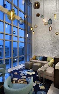 Modern Hotel Lighting Adorns Lobby of Hilton Resort in Myrtle Beach - Photo 2 of 4 -