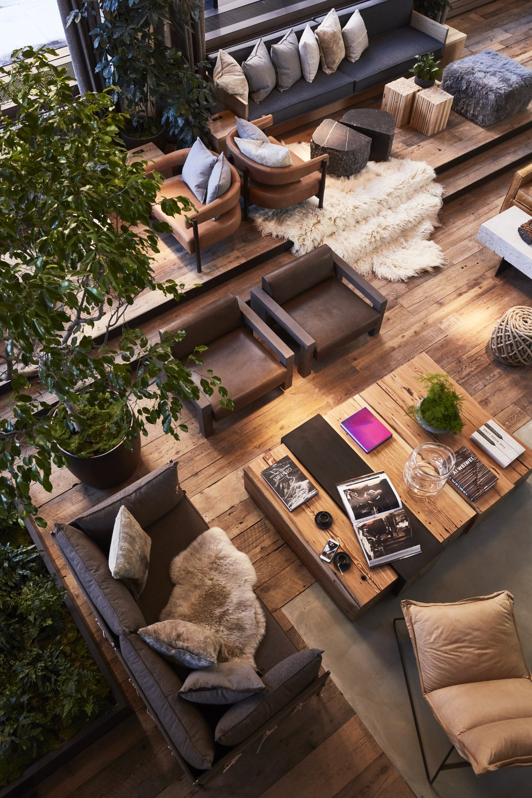 Living Room, Bench, Chair, Sofa, Recliner, Ottomans, Coffee Tables, Table, Medium Hardwood Floor, and Concrete Floor  Photo 5 of 13 in On the Waterfront:  1 Hotel Brooklyn Bridge