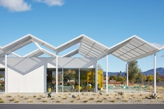 The tasting room is shaded by a folded plate canopy that recalls the modernist designs of architect Donald Wexler.