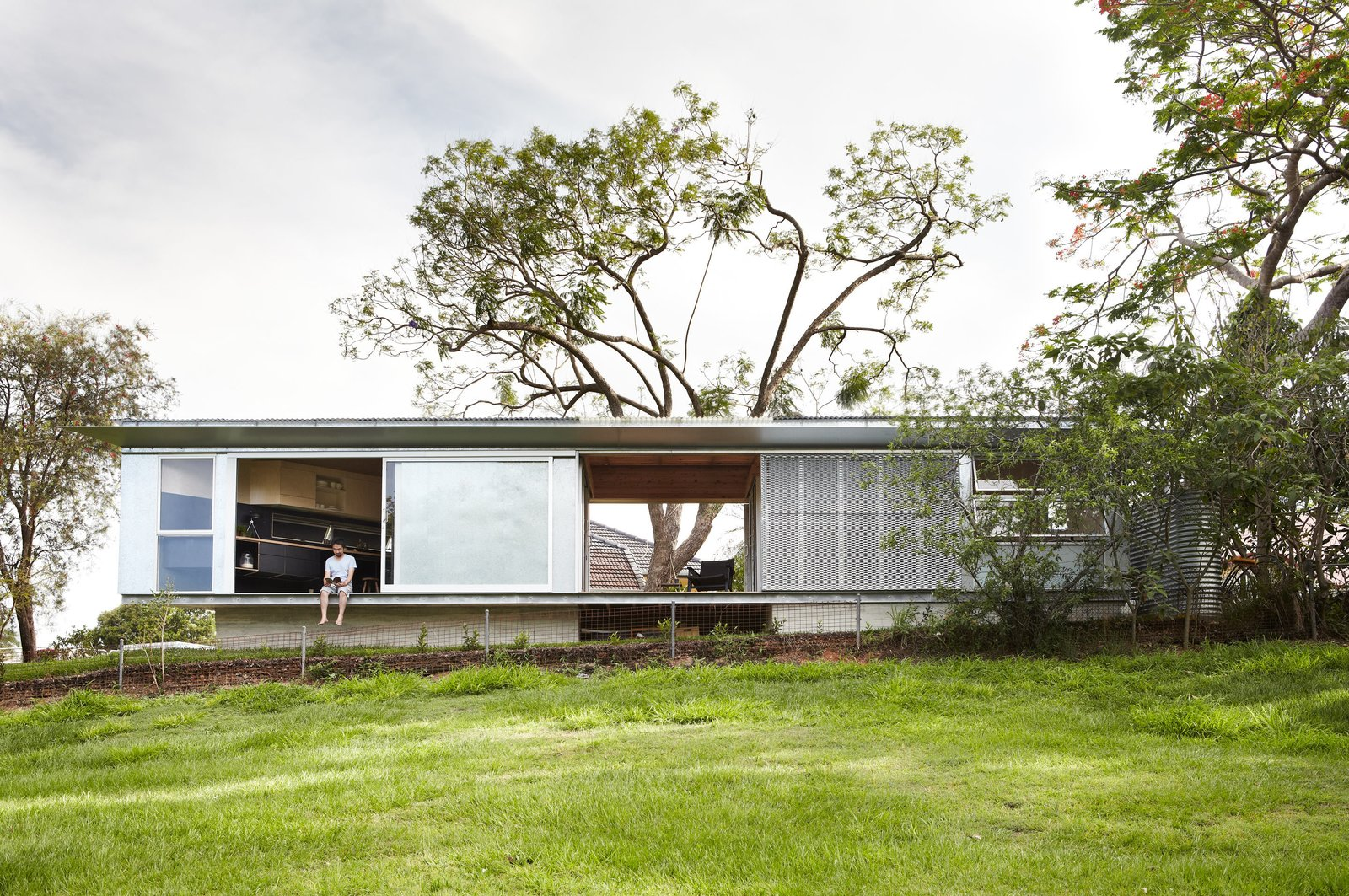 Exterior, Metal Roof Material, Concrete Siding Material, House Building Type, Shed RoofLine, and Metal Siding Material  Photo 1 of 10 in A Retired Teacher's Tiny House Opens Wide to the Landscape in Brisbane, Australia