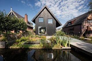 A Black Timber Tiny Home Brings Attitude to Amsterdam