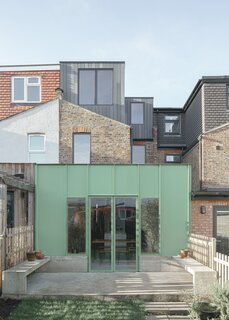 A 1920s London Home Is Revived With a Mint-Green Aluminum Addition