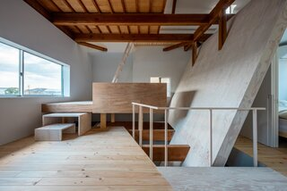 A Family's Home in Kyoto Balances Light and Darkness With a Diagonal Wall