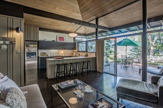 Brilliantly designed by architect James E. Norman, this home is striking and one-of-a-kind. The rock wood-burning fireplace, curved rock wall entrance and exposed post and beam construction all lend themselves to defining this mid-century modern's wholly unique style.