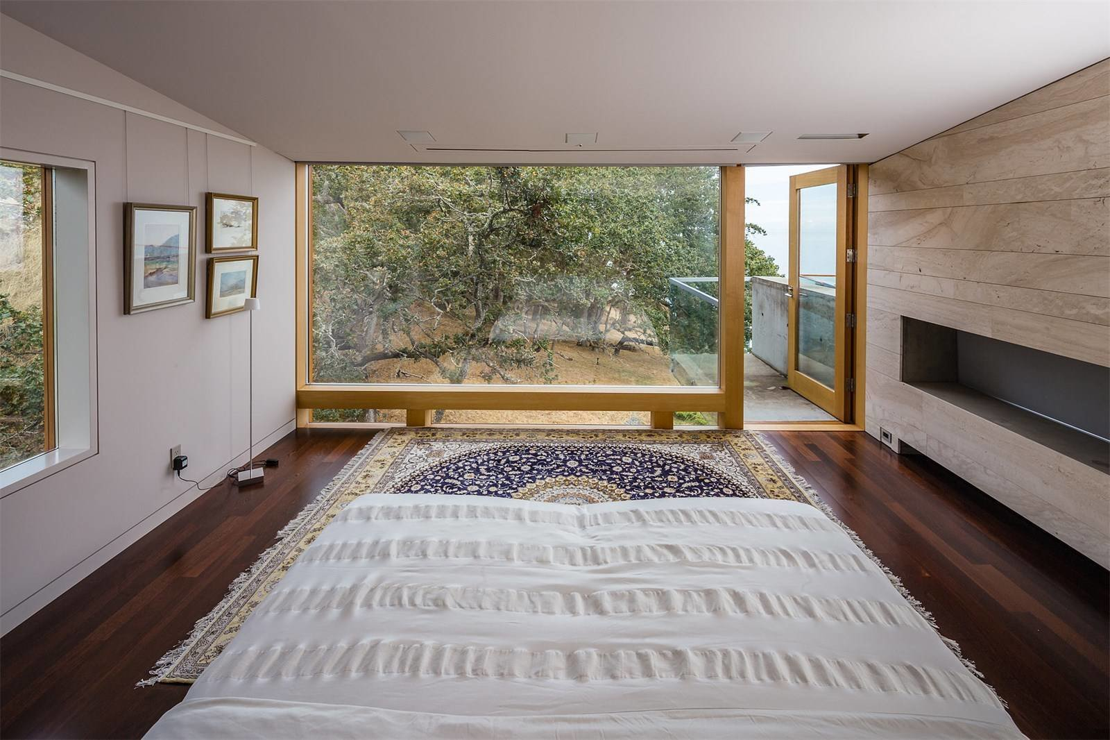 Bedroom, Rug, Floor, Ceiling, Bed, Lamps, and Dark Hardwood  Best Bedroom Lamps Dark Hardwood Photos from Award-Winning Oceanfront Property in BC Asks $19.9M