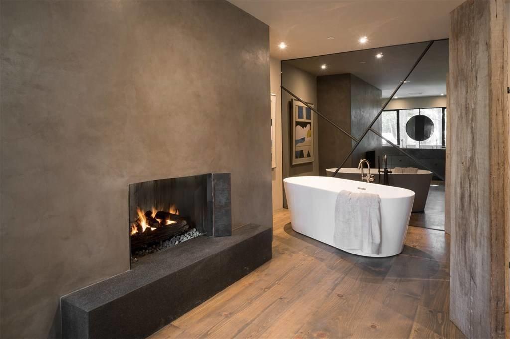 Bath Room, Dark Hardwood Floor, Soaking Tub, Recessed Lighting, and Freestanding Tub  A Sleek Residence on California's Central Coast Asks $3.9M