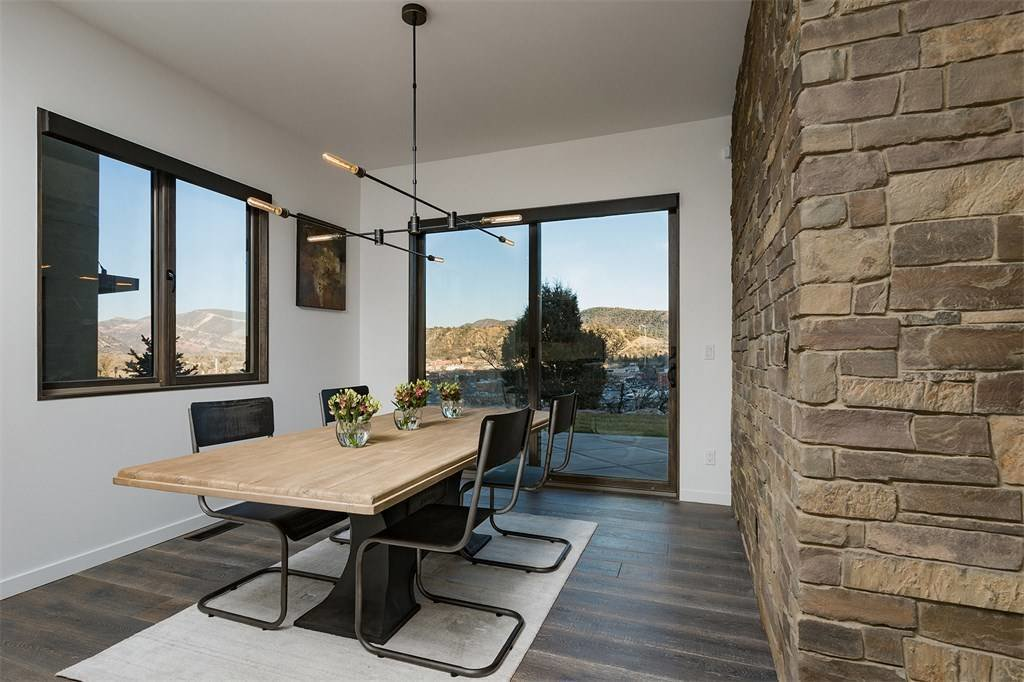 Dining Room, Rug Floor, Dark Hardwood Floor, Table, Chair, and Pendant Lighting  Remarkable Residence with Mountain Views in Colorado Asks $1.29M