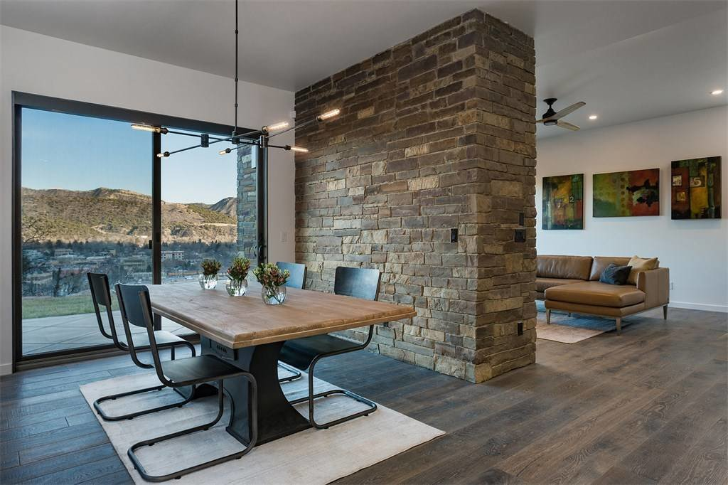 Dining Room, Table, Rug Floor, Chair, Dark Hardwood Floor, and Pendant Lighting  Remarkable Residence with Mountain Views in Colorado Asks $1.29M