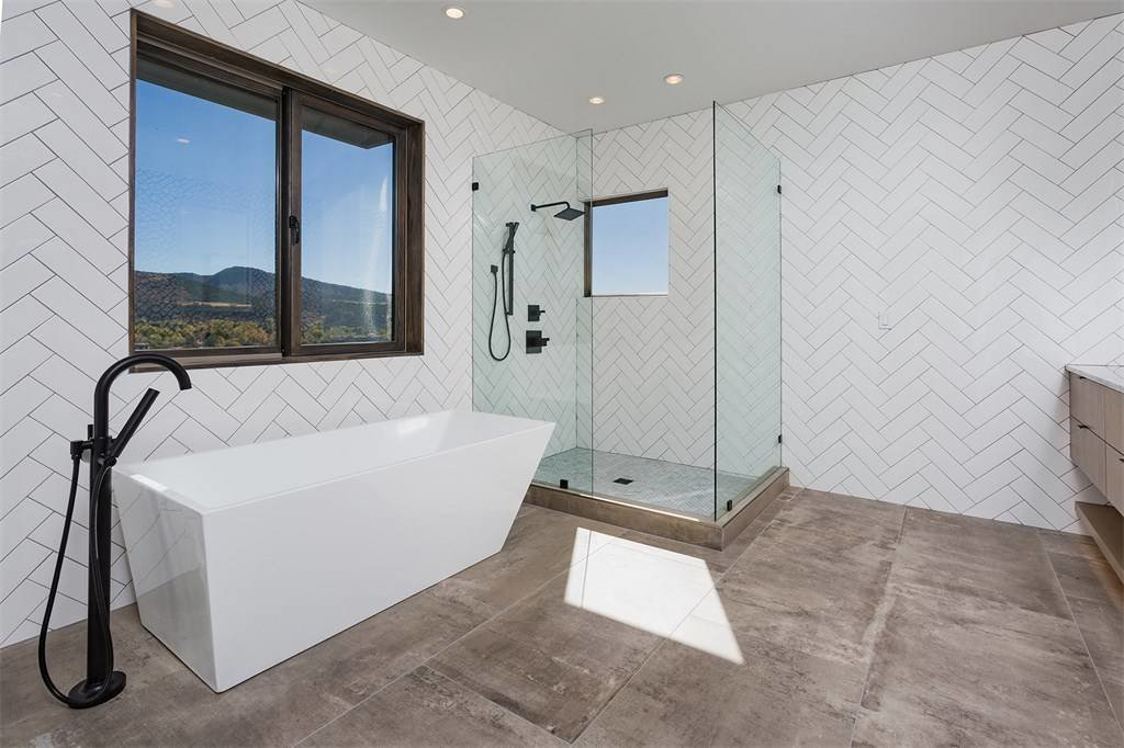 Bath Room, Full Shower, Open Shower, Corner Shower, Freestanding Tub, and Recessed Lighting  Remarkable Residence with Mountain Views in Colorado Asks $1.29M