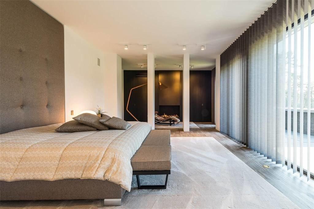 Bedroom, Medium Hardwood Floor, Table Lighting, Ceiling Lighting, Rug Floor, Bed, and Bench  Prestigious Modern Villa in Belgium Asks $6.8M