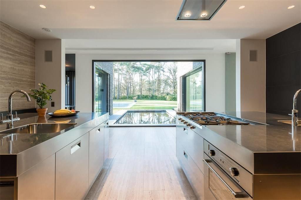 Kitchen, Wall Oven, Medium Hardwood Floor, Cooktops, and Recessed Lighting  Prestigious Modern Villa in Belgium Asks $6.8M