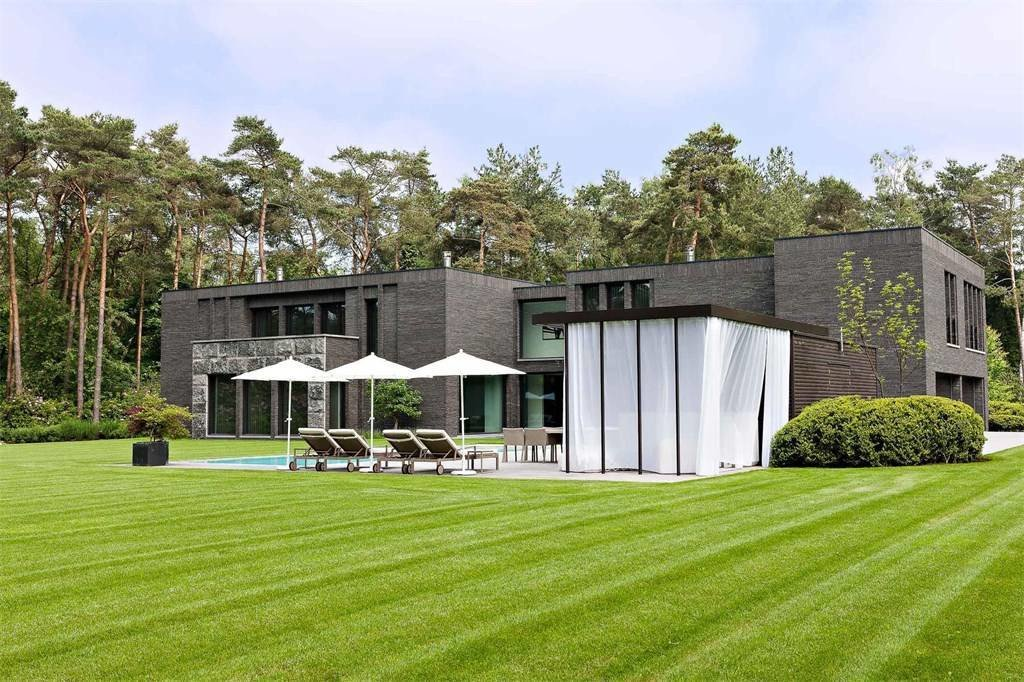 Outdoor, Large Pools, Tubs, Shower, Grass, Back Yard, Large Patio, Porch, Deck, and Trees  Prestigious Modern Villa in Belgium Asks $6.8M