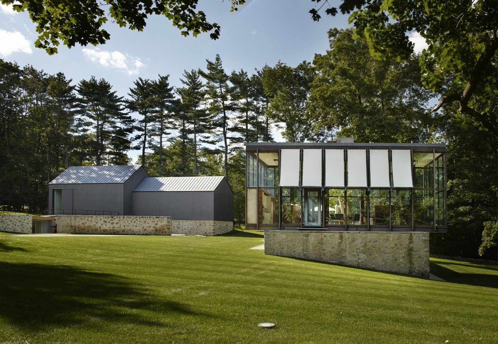 Exterior, Glass Siding Material, Gable RoofLine, Stone Siding Material, Mid-Century Building Type, Flat RoofLine, House Building Type, and Metal Siding Material  Best Photos from A Midcentury Marvel Designed by Philip Johnson in New Canaan Asks $8.5M