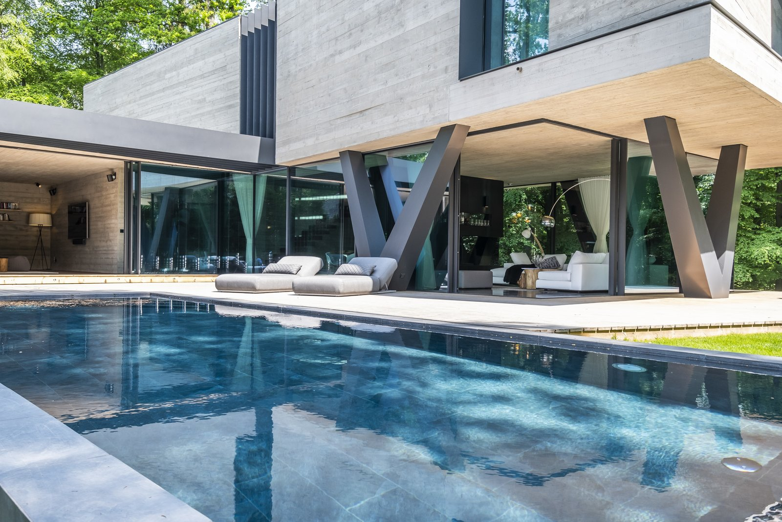 Outdoor, Large Patio, Porch, Deck, Back Yard, Large Pools, Tubs, Shower, Swimming Pools, Tubs, Shower, Grass, and Concrete Patio, Porch, Deck  A Sculptural Abode in Germany Asks $3.59M