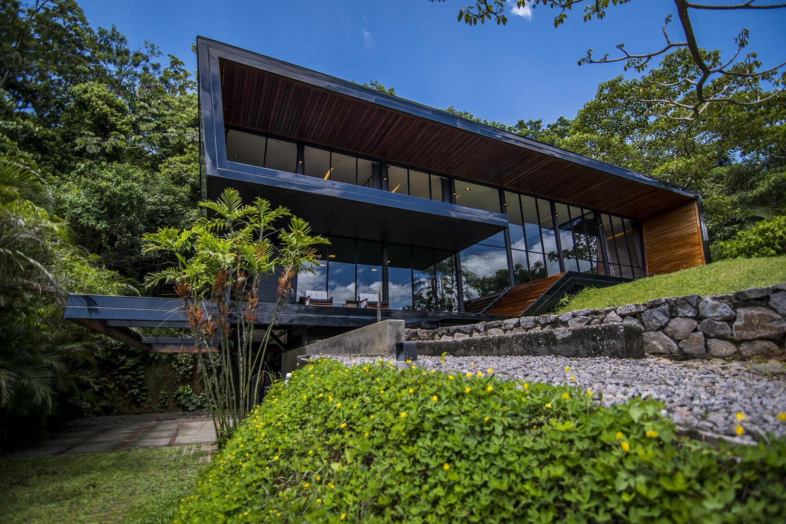 Exterior, Flat RoofLine, and House Building Type  A Harmonious Forest Residence in Costa Rica Asks $1.05M