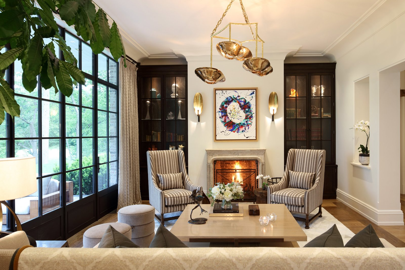 Modern home with Living Room, Coffee Tables, Standard Layout Fireplace, Rug Floor, Pendant Lighting, Medium Hardwood Floor, Chair, Wall Lighting, and Sofa. Photo 2 of A Richard Landry-Designed Home in Massachusetts Asks $39.5M