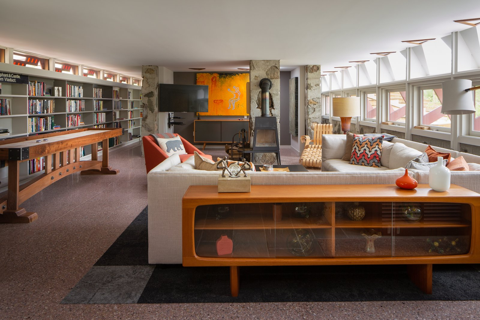 Living, Sectional, Chair, Storage, Rug, Media Cabinet, and Table  Living Sectional Storage Photos from A Modernist Retreat in New York Designed by Two Colleagues of Frank Lloyd Wright Asks $1.4M