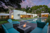Modern home with Outdoor, Back Yard, Grass, Walkways, Large Pools, Tubs, Shower, Wood Patio, Porch, Deck, and Large Patio, Porch, Deck. Photo 2 of A Glowing Home in Florida Asks $4M