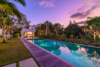 Modern home with Outdoor, Grass, Large Pools, Tubs, Shower, Wood Patio, Porch, Deck, Lap Pools, Tubs, Shower, and Back Yard. Photo 5 of A Glowing Home in Florida Asks $4M