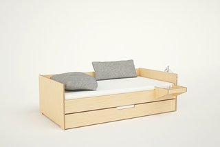 The Cabin Daybed also comes with additional features such as sliding drawers below the bed and a hanging tray.