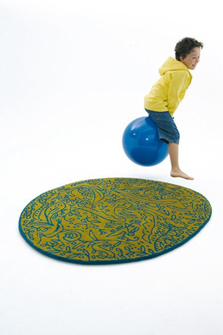 It is easy to imagine that this whimsical rug could play just as well in a child's room as in a common living area.  Photo 1 of 8 in Think Beyond the Nursery Days With These 11 Hardworking Pieces For Your Kid's Room