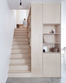 Clean lines, plywood, and ample hidden storage give this home a sleek and contemporary look.