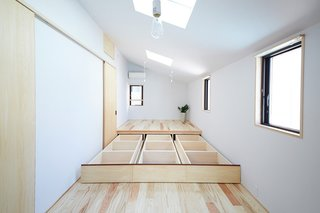 """This Japanese home features a clever built in storage design—a """"hidden space,"""" under a raised platform."""