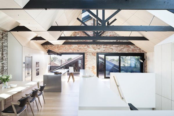 """A high-performance, heavily tinted glass was used within the skylights' double-glazed units to reduce summer heat,"" Simpson says. Autex Industries provided the insulation for the year's cooler months, and the addition of a second, more geometric ceiling hides modern-day electrical and mechanical cords.  Photo 3 of 10 in 9 Inspirational Examples of Adaptive Reuse"