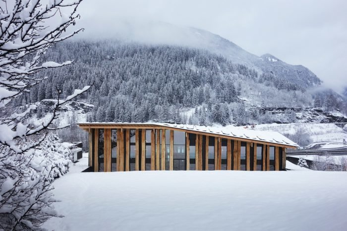 The wide and grand roof of the structure is composed of the unskinned planks designed to harmonize with the terrain.  Photo 10 of 13 in Architect Spotlight: 12 Works by Japanese Architect Kengo Kuma