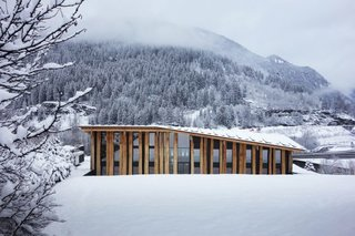The wide and grand roof of the structure is composed of oak planks that are designed to harmonize with the terrain.