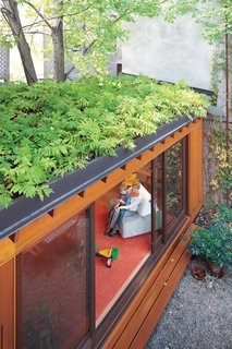 A green roof helps make up for lost garden space and creates a beautiful leafy view from the second and third floors. In summer, when the sliding doors are left wide open, indoor and outdoor spaces blend together.