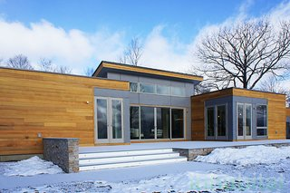 "The ""Breezehouse"" is a 2,420-square-foot prefab home by Blu Homes in the Hudson Valley.  The soaring ceilings and open floor plan allow for spacious, light-filled rooms."
