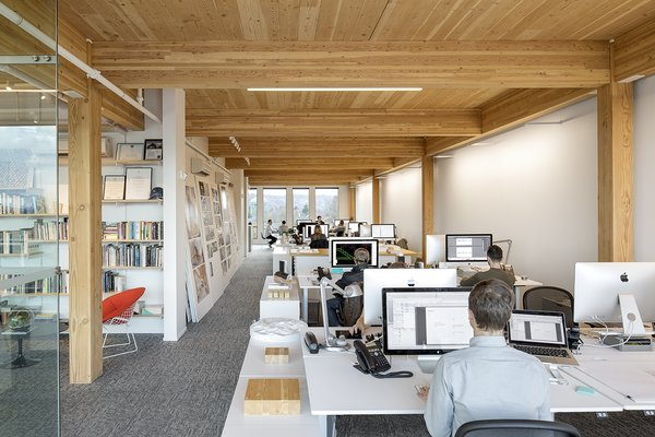 """""""For a creative office like this, we wanted more open space, so we combined a CLT floor with glue-laminated columns and beams. They work as a system,"""" explains Robinson about LEVER Architecture's office space."""