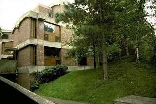 """Maisons Jaoul is pair of houses built for André Jaoul and his son Michel in the upscale Paris suburb of Neuilly-sur-Seine. A departure from his white squares, the homes are among Le Corbusier's most important post-war structures and feature unpainted cast-concrete—""""béton brut""""—together with rugged brickwork."""