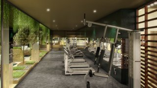 """The use of foliage is our interpretation of 'greenery,' which is the Pantone color of the year—as it brings the same fresh feeling to the interiors"". - Design Command. Pictured is the gym."