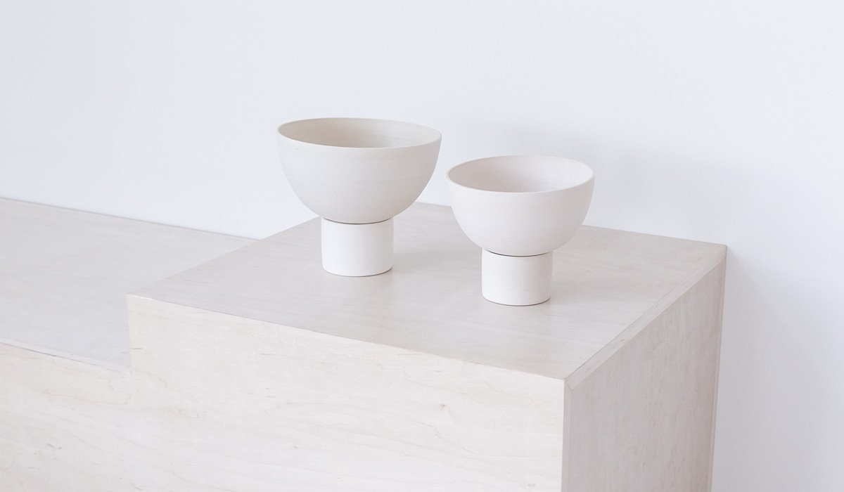 Kati Von Lehman is a Portland ceramicist that we collaborate with a lot. I am excited about the new pedestal planters that just arrived that have a stand at the bottom that catches the water drainage from the pot.  Photo 8 of 12 in The Carefully-Curated Spartan Shop Expands Into a Creative Consultancy