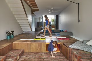 The Mill House in Melbourne, Australia, by Austin Maynard Architects incorporates a kind of giant toy box beneath the floor of the main living space.