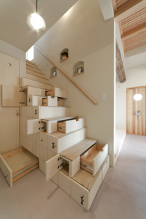 This home in Koriyama, Japan, by Architect Kotaro Anzai, takes its cues from traditional Japanese carpentry techniques that use staircases to maximize storage.