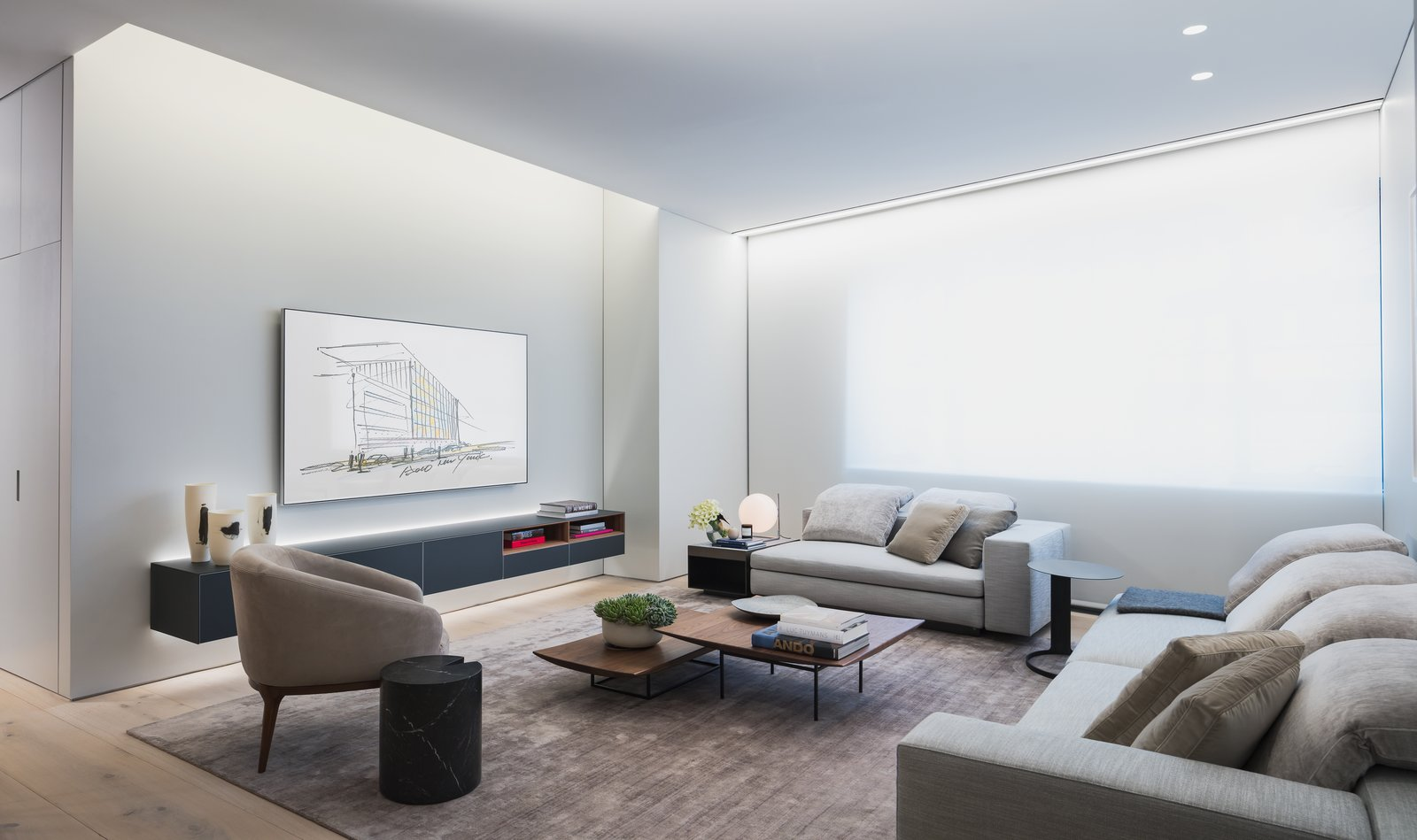 Living Room Six-foot tall operable windows capture and diffuse the abundance of natural light throughout the home, while nine-foot-tall floating white ceilings and wall planes create a sense of continuous space.  Photo 6 of 10 in A Look Into NYC's 152 Elizabeth Street, Tadao Ando's First Residential Project Outside of Asia