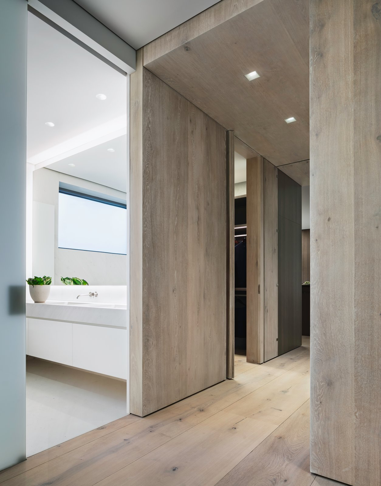 Hallway The flooring is comprised of wide-plank Danish oak from Dinesen, which is also featured in select wall panels and used to create the thick, full-height doors to the master bedroom.  Photo 8 of 10 in A Look Into NYC's 152 Elizabeth Street, Tadao Ando's First Residential Project Outside of Asia