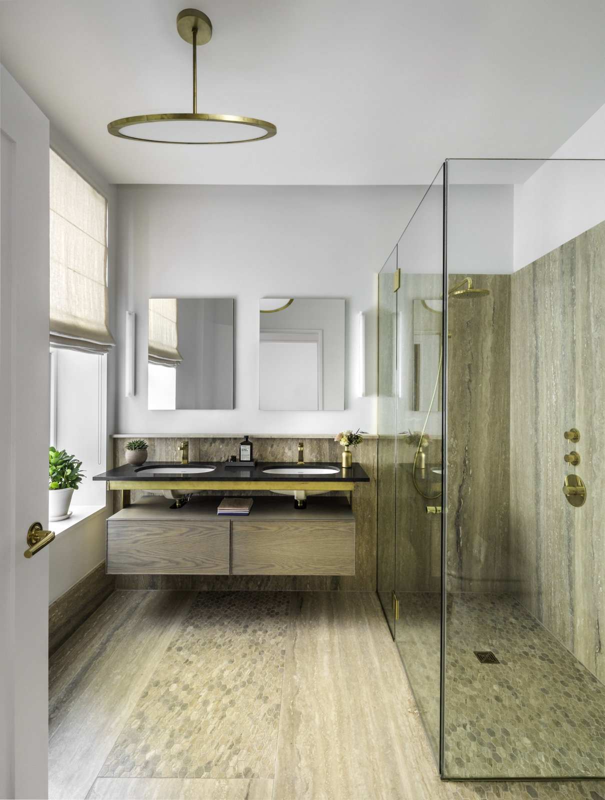 The	master	bath	includes	silver	travertine	slabs	and	mosaic	accented	walls	and	flooring,	as	well	as	a	custom	freestanding	tub	and	Fantini	rain	shower.  Photo 8 of 9 in Formerly Home to Superman, The Standish Offers Modernized Beaux-Arts Condos From $1.3 Million